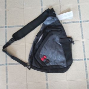 NWT anti theft camo sling bag with USB